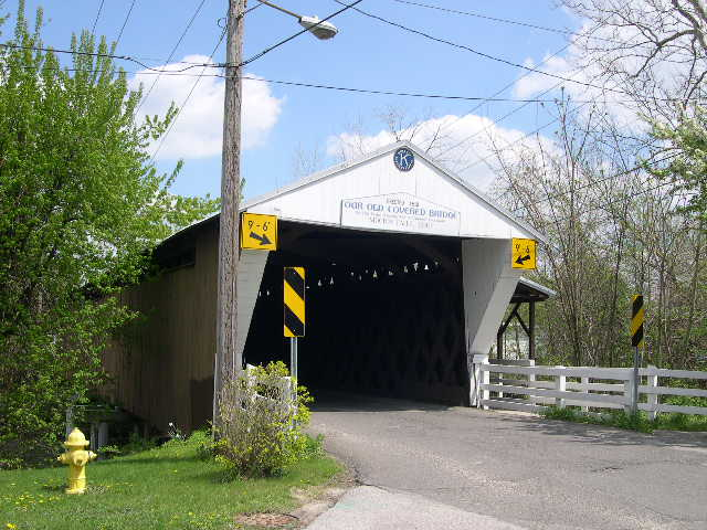 Constructed in 1831, the bridge still accommodates autos over the East Branch of the river. It is the second oldest covered bridge in the state, the only one in Ohio with a covered crosswalk, and the last covered bridge in Trumbull County.