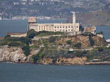 In 1850, a presidential order set aside the island for possible use as a United States military reservation. The California Gold Rush, the resulting boom in the growth of San Francisco, and the need to protect San Francisco Bay led the U.S. Army to build a Citadel, or fortress, at the top of the island in the early 1850's. The Army also made plans to install more than 100 cannon on the island, making Alcatraz the most heavily fortified military site on the West Coast. Together with Fort Point and Lime Point, Alcatraz formed a