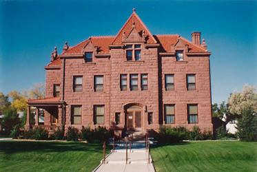 The Moss Mansion Historic House Museum is located in Billings, Montana on 914 Division St. It is a turn of the century, red-stoned mansion built by P.B. Moss.